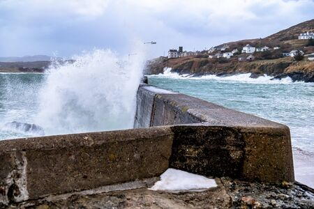 Crashing ocean waves in Portnoo during storm Ciara in County Donegal - Ireland.