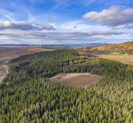 Aerial of forest next to the town Glenties in County Donegal - Ireland. Фото со стока