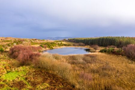Aerial of lake in a peatbog by Clooney, Portnoo - County Donegal, Ireland