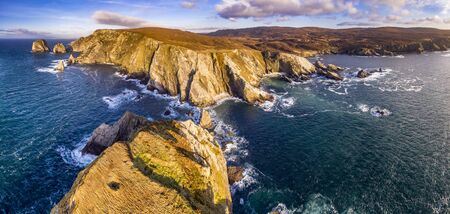 Aerial view of the amazing coast by Port in County Donegal - Ireland / Toralaydan Island, Stea Stacks: Baltic Spire, An Bhuideal, Tormore Island, Cnoc na mara