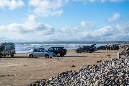 ROSSNOWLAGH / IRELAND - AUGUST 26, 2020: Cars parking and driving on the beach