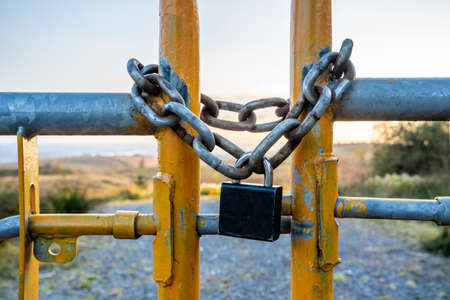 Padlock and chain at gate in wild Ireland