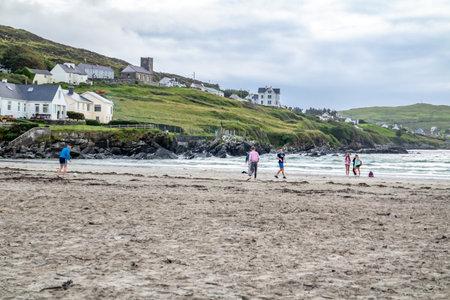 PORTNOO, COUNTY DONEGAL , IRELAND - AUGUST 18 2020: Folks enjoying Narin beach during the pandemic