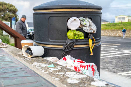 PORTNOO, COUNTY DONEGAL , IRELAND - AUGUST 18 2020: Dustbin is overly full during the pandemic