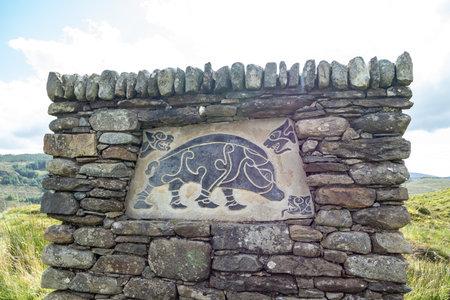 FINTOWN , IRELAND - NOVEMBER 03 2020 : The stone monument is overlooking Lough Muck Redakční