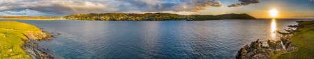 Sunset seen from Inishkeel Island by Portnoo harbour in County Donegal, Ireland Reklamní fotografie