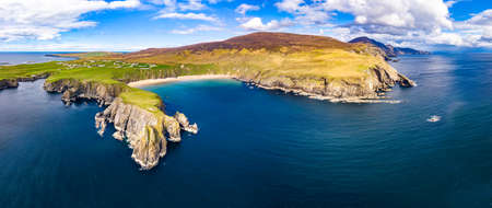 Aerial view of the beautiful coast at Malin Beg with Slieve League in the background in County Donegal, Ireland