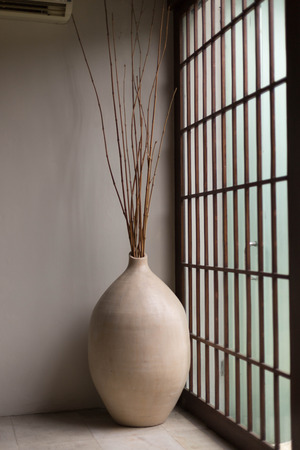 seminyak: Japanese inspired interior design with a big clay vase