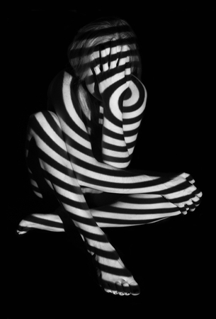 Black and white projection on a female naked body. Reklamní fotografie