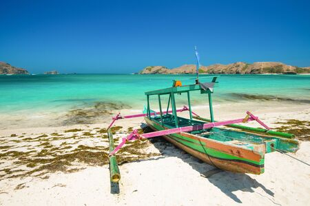 Fishing boat on Tanjung Aan Beach - Lombok, Indonesia. Stock Photo