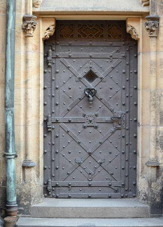 Medieval front door in the Prague castle, Czech Republic.