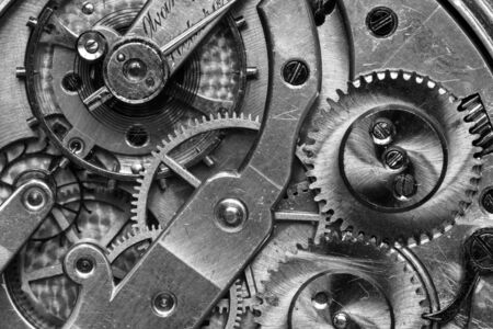 Old Clock Watch Mechanism with gears - close-up, black and white. Standard-Bild