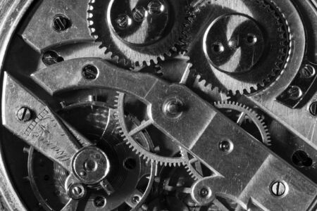 Old Clock Watch Mechanism with gears - close-up, black and white.