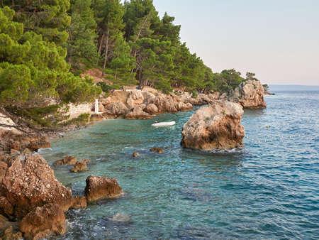 Punta Rata Beach in Brela. Stone symbol of Brela. One of the most beautiful beaches in Croatia on the turquoise Adriatic Sea.
