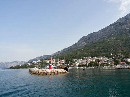 Panorama of Baska Voda in Croatia. View of the marina and Biokovo Mountain from the sea.