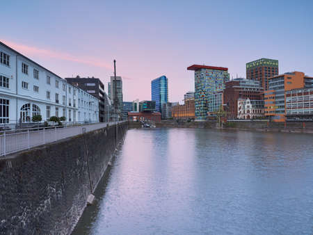 Düsseldorf, Germany - Medienhafen at dawn. The urban landscape at the blue hour. Cityscape before sunrise. Imagens