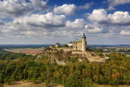 Aerial photo of beautiful medieval castle Kun's mountain near the city of Pardubice in the heart of Czech Republic on the top of the hill in Surrouding lowlands and villages nearby from ultralight plane Imagens