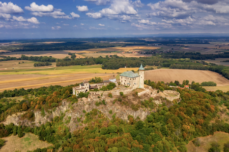 Aerial photo of beautiful medieval castle Kunětická hora near city of Pardubice in the heart of Czech Republic on the top of the hill in surrouding lowlands and villages nearby from ultralight plane