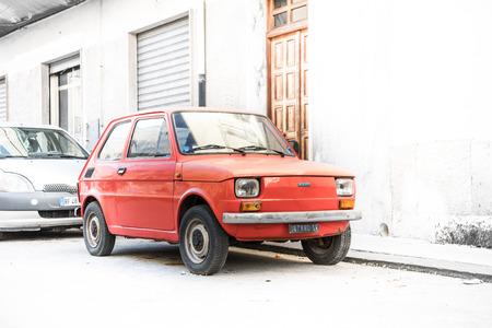 Ortigia, Syracuse, Italy / December 2018: Red old Fiat 126 Bambino parked on old street Redakční