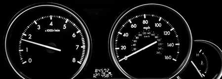 Car dashboard dials - engine RPM and speedometer