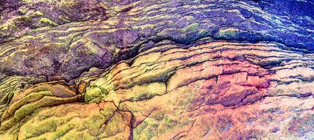 Purple, red, orange, green sediments and minerals, rock formations - a colorful rocks stacked over the hundreds of years