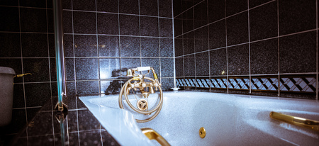 Brass vintage retro tap faucet - luxury bathroom with jacuzzi in modern house
