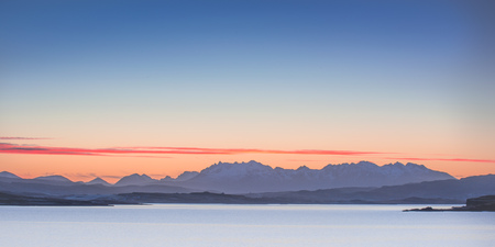 Isle of Skye landscape - orange and blue sky over mountains at sunrise