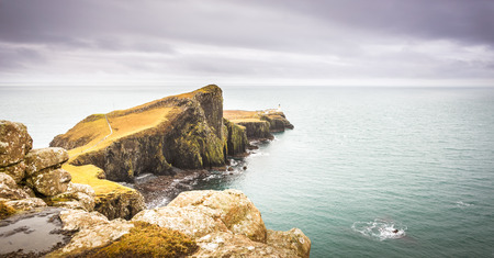 Isle of Skye landscape - Neist Point lighthouse, rocky cliffs, Atlantic Ocean