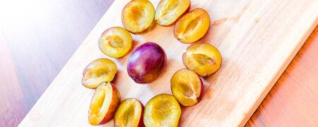 Plums - sweet and juicy plum fruit cut in half