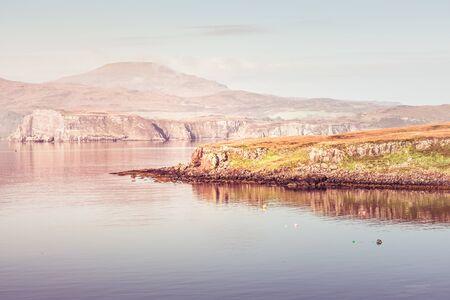 Misty island - Isle of Skye covered in morning mist