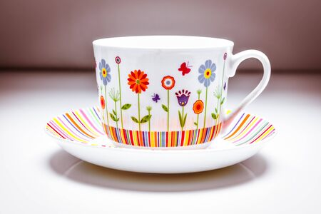 Coffee cup and saucer - colourful and stylish afternoon tea set Banco de Imagens