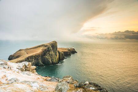 Isle of Skye winter landscape - Neist Point lighthouse and storm over ocean Banco de Imagens