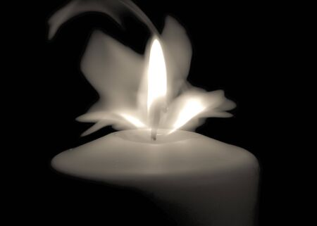 Candle flame in the dark background and space for text Banco de Imagens - 130734661