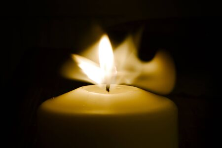 Candle flame in the dark background and space for text Banco de Imagens - 130734662
