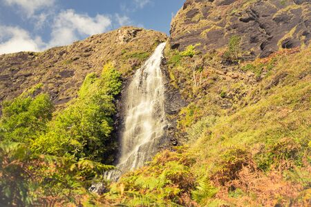 Tiny waterfall on the way to abandoned village Boreraig on the Isle of Skye