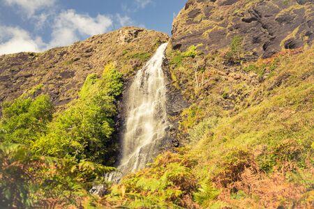 Tiny waterfall on the way to abandoned village Boreraig on the Isle of Skye Banco de Imagens - 130734755