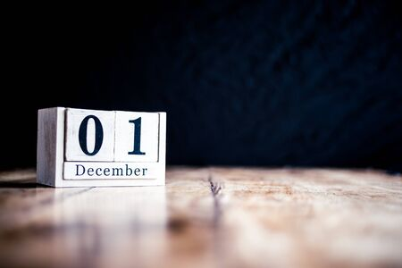December 1st, 1 December, First of December - White block calendar on vintage table present date on dark background Фото со стока
