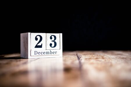 December 23rd, 23 December, Twenty Third of December - White block calendar on vintage table - Date on dark background