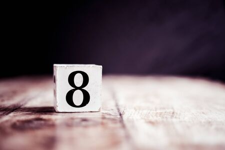 Number 8 isolated on dark background- 3D number eight isolated on vintage wooden table