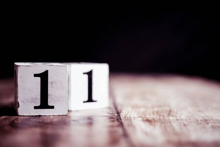 Number 11 isolated on dark background- 3D number eleven isolated on vintage wooden table