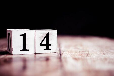 Number 14 isolated on dark background- 3D number fourteen isolated on vintage wooden table