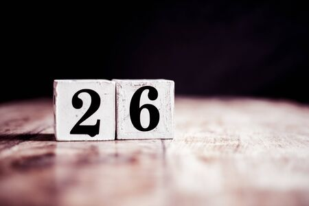 Number 26 isolated on dark background- 3D number twenty six isolated on vintage wooden table