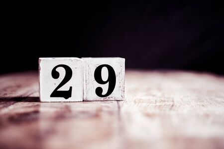 Number 29 isolated on dark background- 3D number twenty nine isolated on vintage wooden table