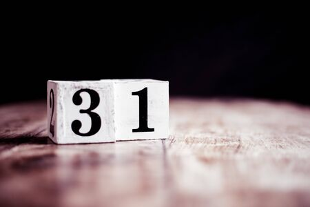 Number 31 isolated on dark background- 3D number thirty one isolated on vintage wooden table Reklamní fotografie