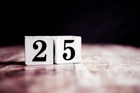 Number 25 isolated on dark background- 3D number twenty five isolated on vintage wooden table