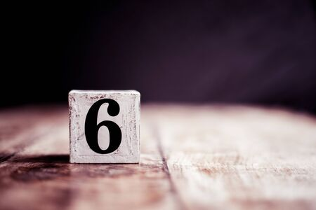 Number 6 isolated on dark background- 3D number six isolated on vintage wooden table