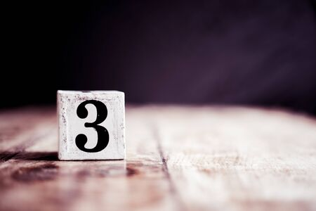 Number 3 isolated on dark background- 3D number three isolated on vintage wooden table