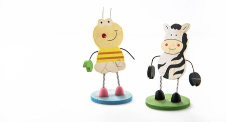 Cow and bee figures isolated on white background Banco de Imagens