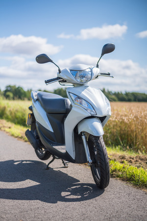 Stirling, Scotland - 15 August 2019: Honda Vision 50cc scooter Banco de Imagens - 128987771