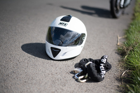 Stirling, Scotland - 15 August 2019: white helmet with motorbike in the background